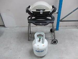 WEBER BABY-Q on Webber trolley with cover and gas bottle Sydenham Marrickville Area Preview