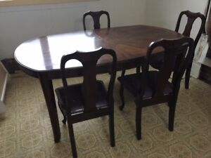 Elegant dining table and chairs, inlaid leaf