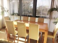 eighter seater wood dining table with leather chairs
