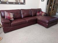 Large Burgundy corner leather sofa and matching swivel cuddle sofa