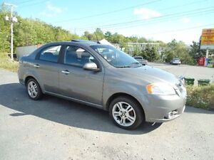 2009 aveo, automatic, with 148000 km , a/c, sunroof , inspected,