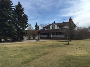 6+/- Acres close to Acme with heated riding arena!