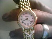 Ladies Movado Museum 18k gold plated bracelet watch,Diamond bezel date new battery new condition