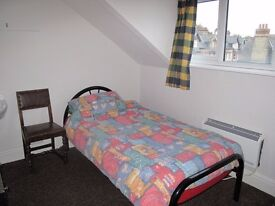 A clean comfortable single room in Mill Road near town centre . Rent inc. bills, wi-fi and w/m .
