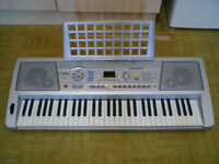 MK-928 Electronic Keyboard with stand.