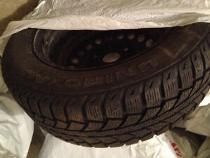 "4 UniRoyal Tiger paw Winter tires on Rims P195/65/15"" West Island Greater Montréal image 1"