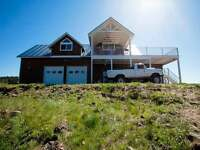 80 Acre Pritchard Home with Custom Features