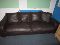 Nice large leather sofa . Brown colour . Great condition.