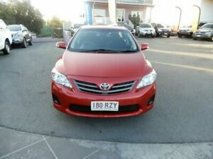 2011 Toyota Corolla ZRE152R MY11 Ascent Red 6 Speed Manual Sedan Coorparoo Brisbane South East Preview