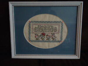 Handmade cross stitching picture hanging