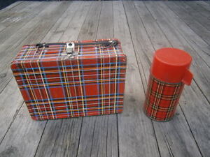 vintage metal lunch box with thermos