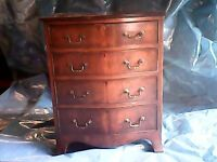 old antique bow fronted draws