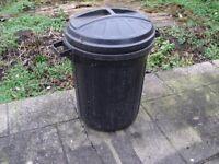 Black plastic waist bin.