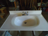Used in good condition vanity top sink with tabs