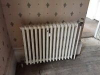 23 Cast iron radiators in working order, various sizes including wall stays
