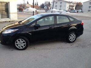 2011 Ford Fiesta with extra set of wheels!