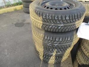 235/65 R17 ACURA RDX WINTER TIRES AND RIMS PACKAGE (SET OF 4) - USED WINTER WARRIOR APPROX. 85% TREAD