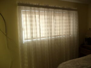 4 sheer curtains and rod.