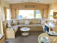 Fantastic value 2 bed static caravan stunning sea views 12 month season pet friendly park