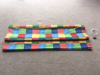 Multi coloured roman blind with black out lining - almost new