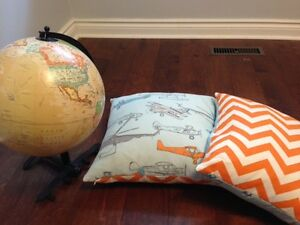 Airplane themed accent pillows and globe