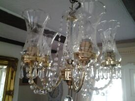 Crystal light fitting....5 arm with glass shades in gold colour.
