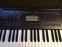 Casio Keyboard CTK 3000 with power cord and bonus stand