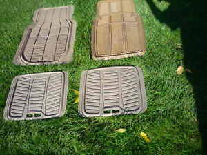 3 Rubbermaid and 1 Motomaster(?) Gently Used Floor Mats.