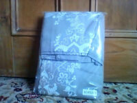 NEW and unopened double duvet cover (may include pillowcases)