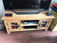 oak TV stand with two doors and space for sky box and DVD