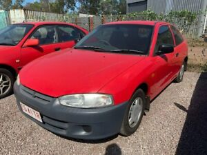 2003 Mitsubishi Mirage CE MY2002 Red 5 Speed Manual Hatchback Durack Palmerston Area Preview