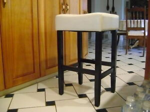 Two Cream Leather Stools