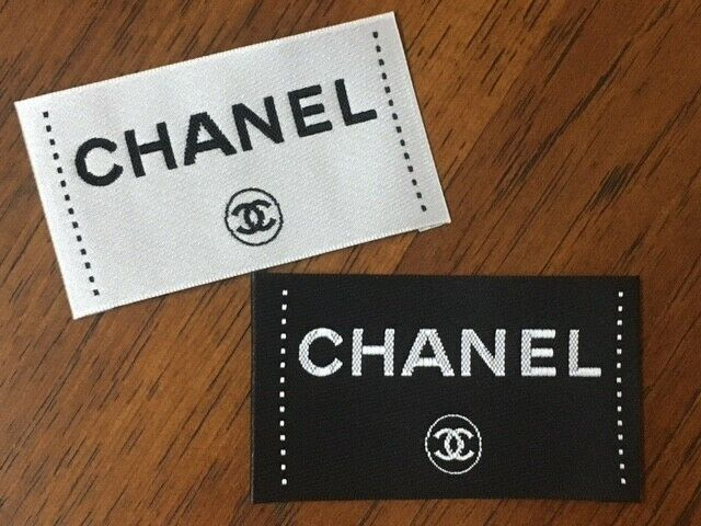 Two Replacement Chanel clothing labels, tags, white and black