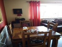 Indian wood dining table and 4 chairs