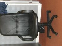 Black leather office chair in perfect condition