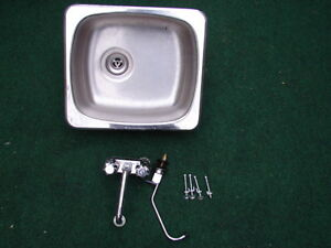 Single sink with taps