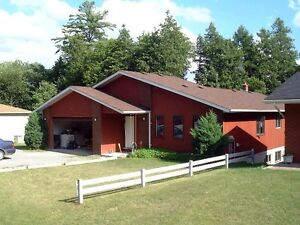 Spacious 3-bedroom bungalow with 2-bdrm in-law suite potential