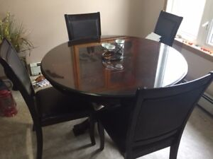 Solid table with  1/2 inch glass