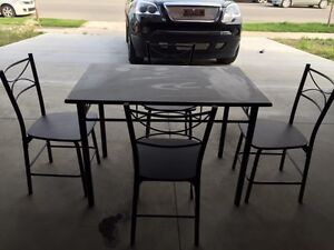 Dinning Table and Set of Four Matching Chairs - $360