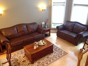 leather couch set with tables