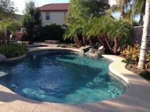 A beautiful 2 story house with swimming pool facing golf course