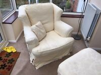 Good condition cream armchair with matching ottoman