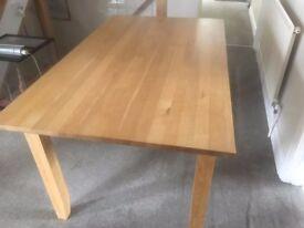Light Oak heavy wood dining table. Seats 6