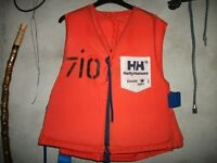 Two Adult Helly Hansen life jackets / buoyancy aids.