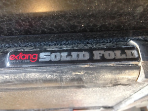 Extang Solid fold tonneau cover fits 2010 GMC