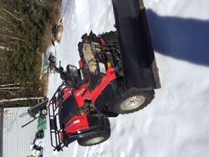 1986 Honda Four Trax with Plow.