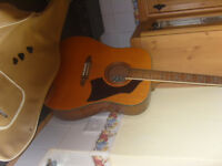 Eko Acoustic Guitar with 3 plectrums; sheet music also