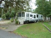 FLORIDA set in the SUN in a 40ft RV PK Mdl with LOT included!