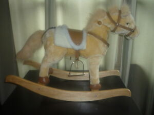 BEAUTIFUL BRAND NEW ROCKING HORSE WITH SOUND AND MOTION