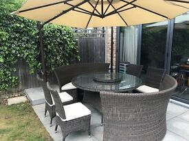 Harbo outdoor dining table with umbrella